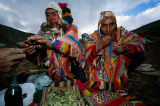 Inca men chewing coca leaves.